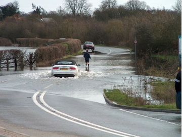 Floooding in Eton Road Datchet in 2014 - The Royal Borough is in the front line of Climate Change